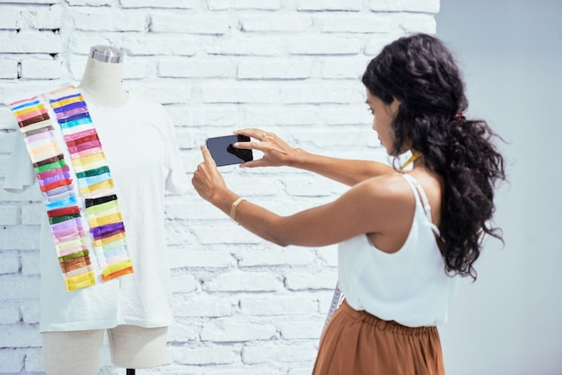 Designer photographing her garment