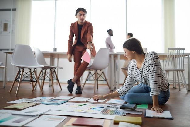 Designer planning project on floor