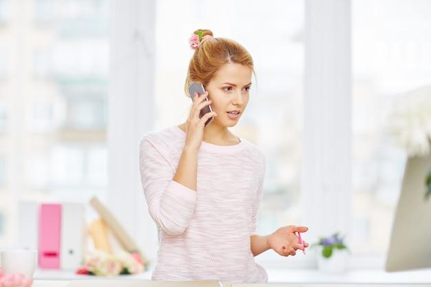 Designer talking on smartphone