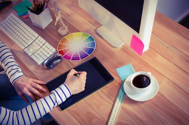 Designer using digitizer on desk