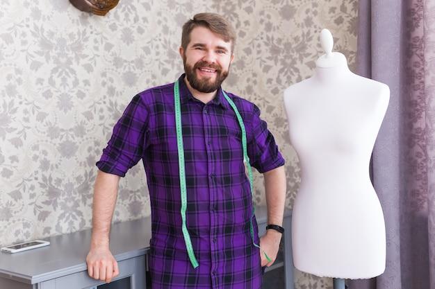 Designer with measuring tape on neck posing