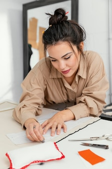 Designer working in her workshop alone