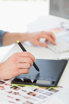 Designer working with digitizer and stylus at his desk