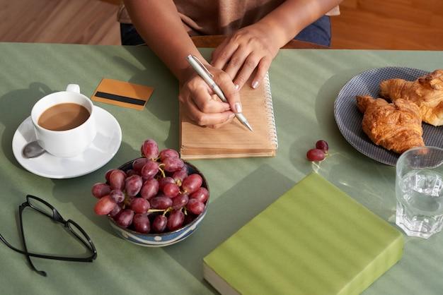 Designer writing down creative ideas