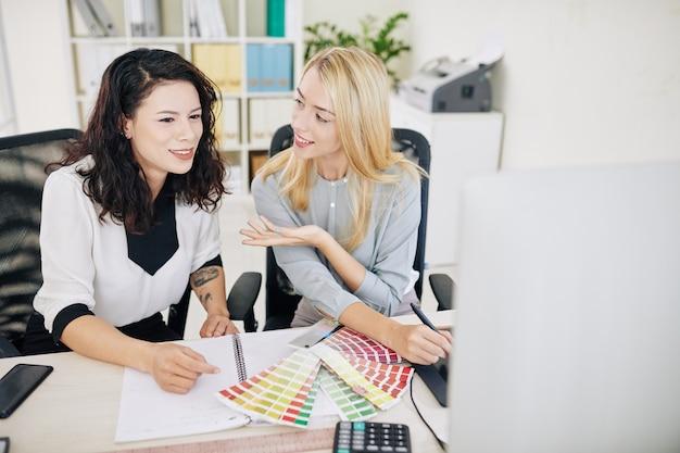 Designers discussing color scheme