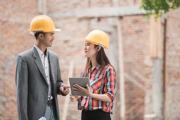 Designers discussing construction plan
