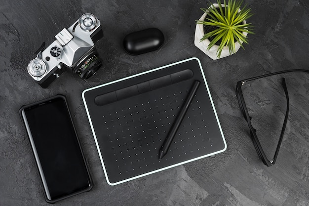 Desk arrangement on slate background top view Free Photo