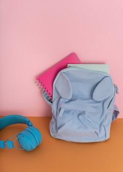 Desk arrangement with backpack and headphones