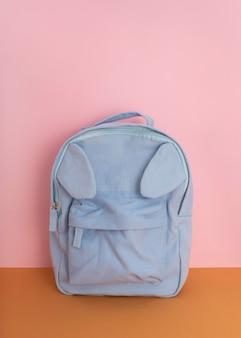 Desk arrangement with blue backpack