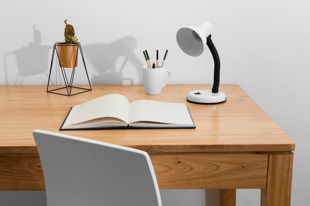 Desk arrangement with book and lamp