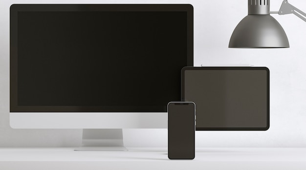 Desk arrangement with devices and lamp