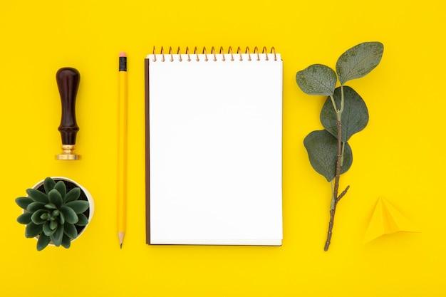 Desk arrangement with empty notepad