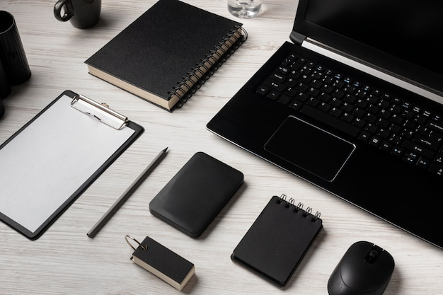 Desk arrangement with laptop and notebooks
