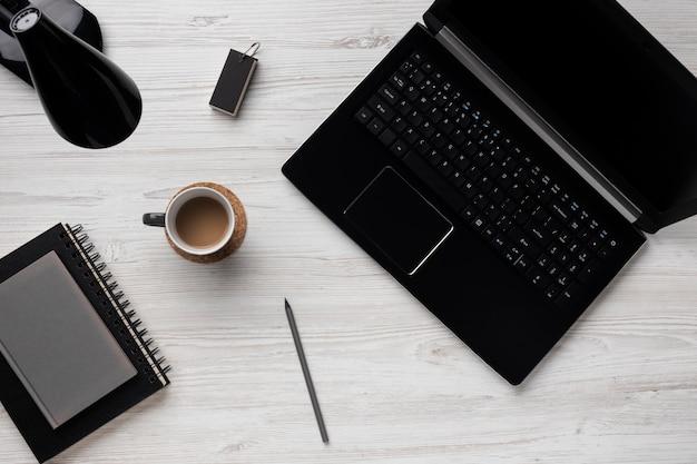 Desk arrangement with laptop above view