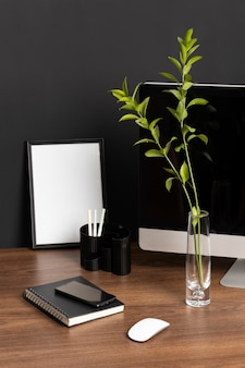 Desk arrangement with monitor and plant