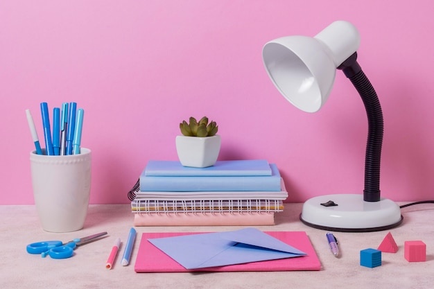 Desk arrangement with pink and blue items