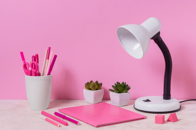 Desk arrangement with pink items