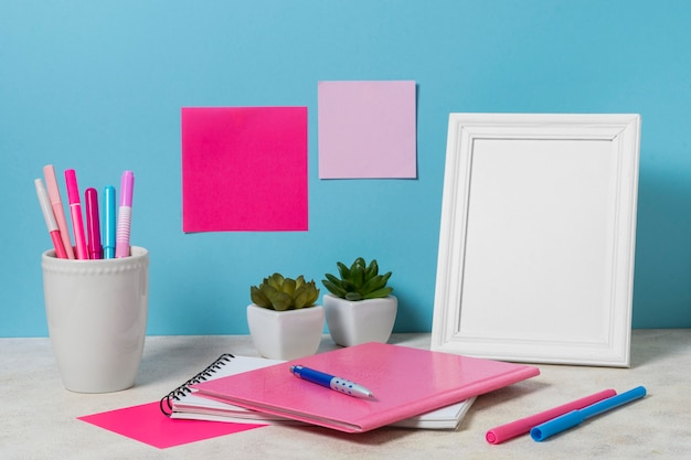 Desk arrangement with pink items