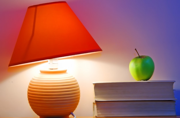 Desk lamp and an apple