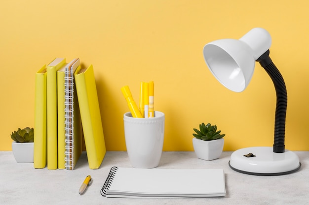 Desk lamp and notebook arrangement