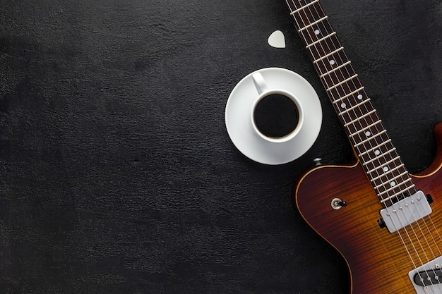 Desk of musician for songwriter work set with headphones and guitar