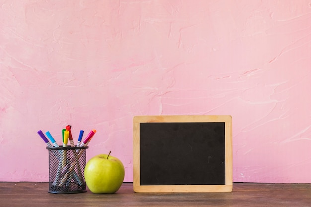 Desk with chalkboard apple and pencil cup
