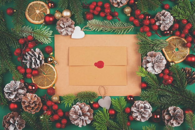 Desk with envelope and christmas decorations. flat lay. mockup