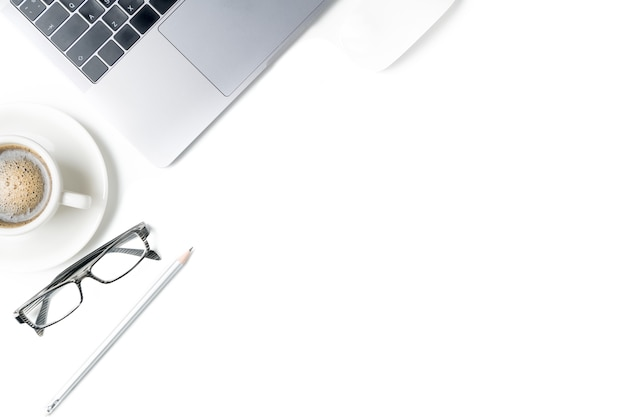 Desk with laptop, eye glasses, pencil and a cup of coffee isolated on white background. top view wit