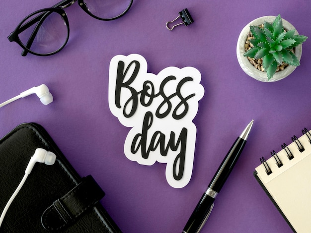 Desk with sign with boss day