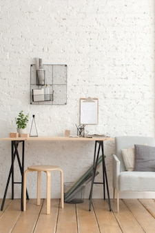 Desk with stationery in the white interior loft