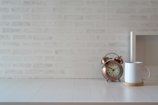 Desk with vintage clock, poster and copy space