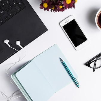 Desk workspace with various elements