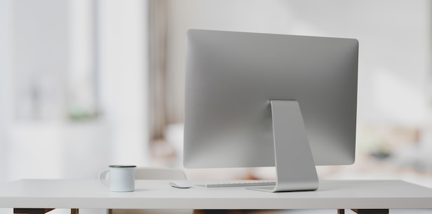 Desktop computer on white table and coffee cup in modern office