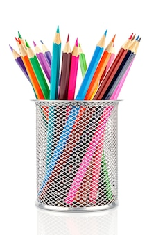 Desktop silver metal mesh holder cup with colored pencils inside isolated on white background