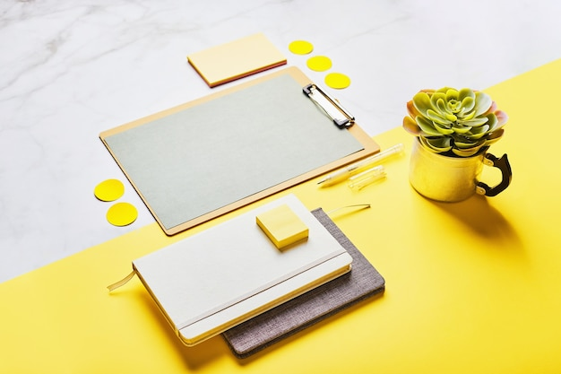 Desktop with clipboard mockup and office supplies. home office, planning goal setting concept.