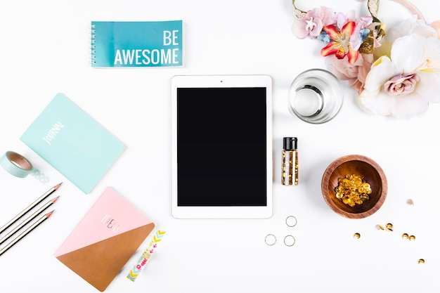 Desktop with tablet diary and notebooks