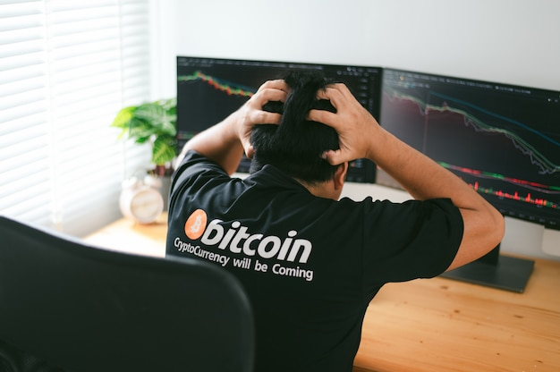 Despair man on down stock bitcoin graph market background