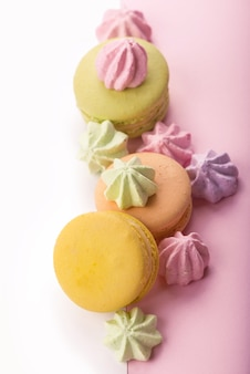 Dessert cake macaron or macaroon on pink background top view.