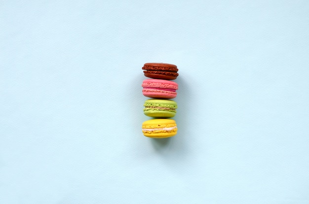 Dessert cake macaron or macaroon on trendy pastel blue background top view