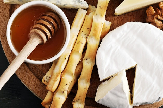 Dessert   cheese breadsticks, honey and nuts
