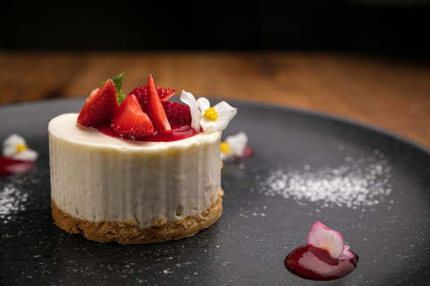 Dessert from the menu of a french restaurant. on a wooden table