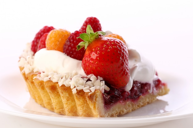 Dessert fruitcake cake with whipped cream