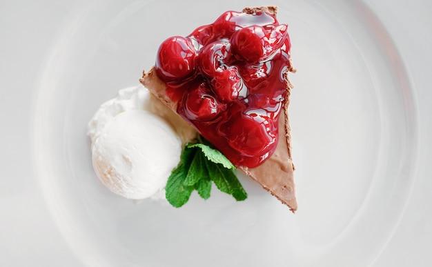 Dessert ice cream chocolate cake cherry mint in cafe