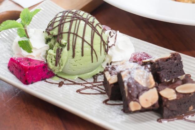 Dessert made of brownie and green tea ice cream