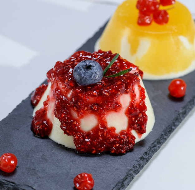 Dessert panacotta with raspberry jam