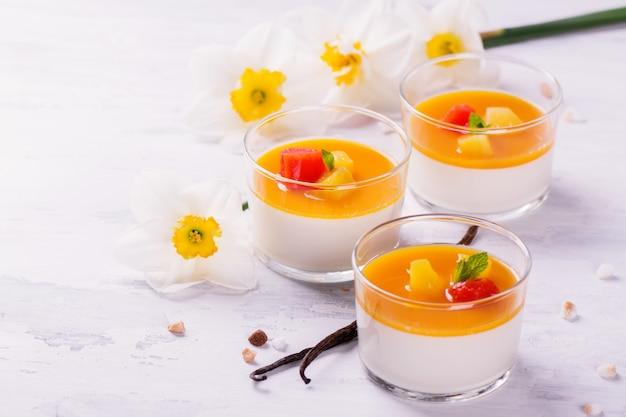 Dessert panna cotta with fresh berries on wooden background
