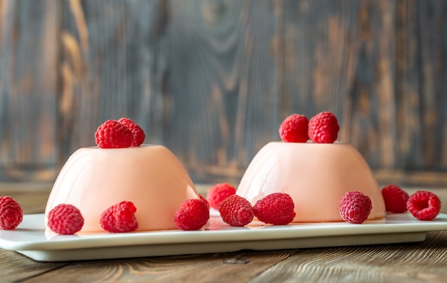 Dessert puddings with raspberries