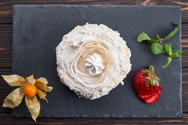 Dessert raffaello, on a dark background. stone, wooden board.