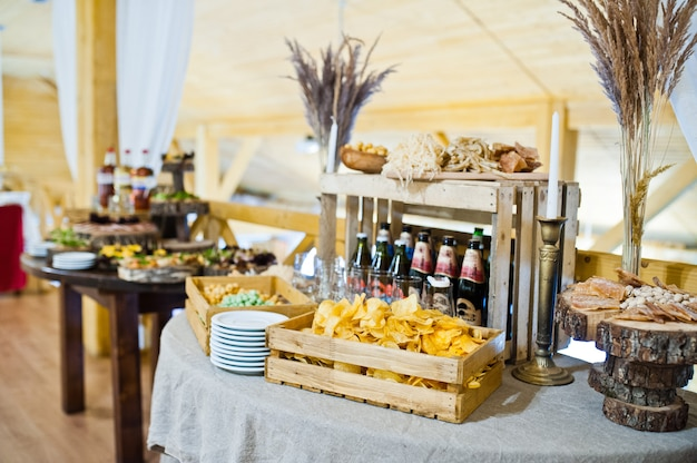 Dessert table of delicious snacks on wedding reception.