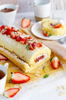 Dessert and tea with strawberry swiss roll food photography